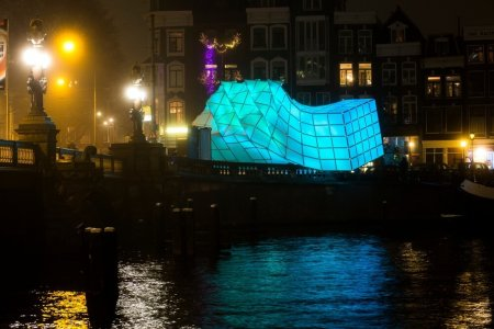 "The ""Eye Beacon"" in Amsterdam in turquoise at night."